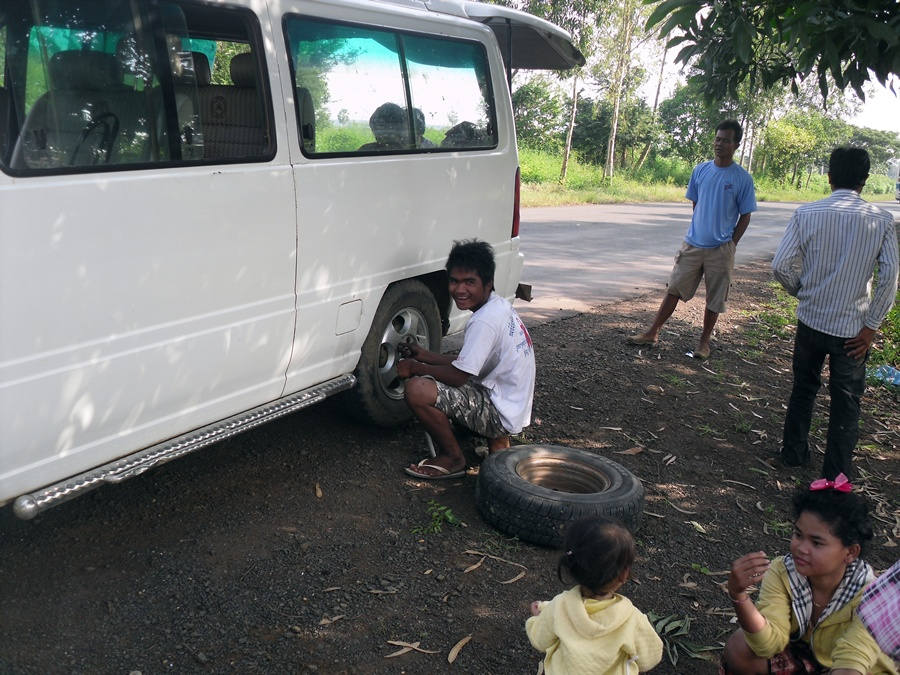 Our driver changing the wheel in Cambodia