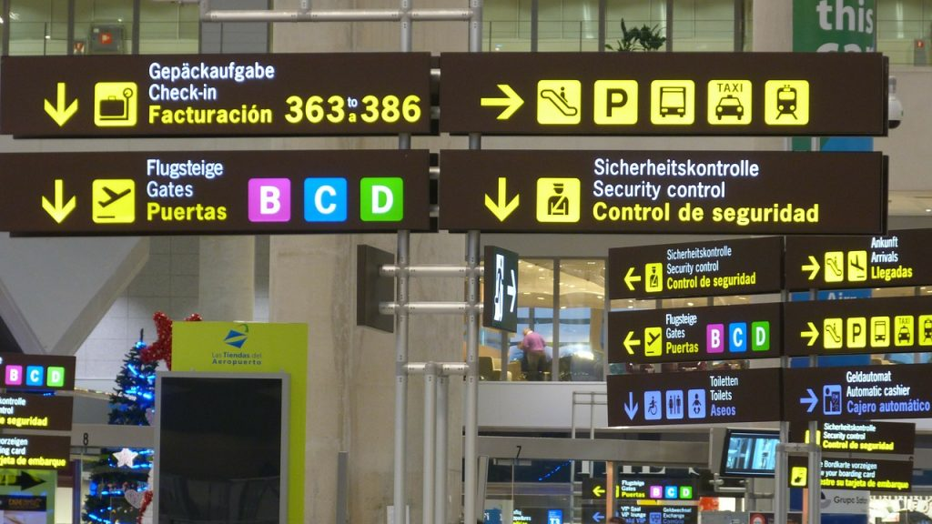 airport signs - solo travellers